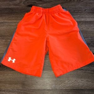 Under Armour youth small, loose fit orange shorts